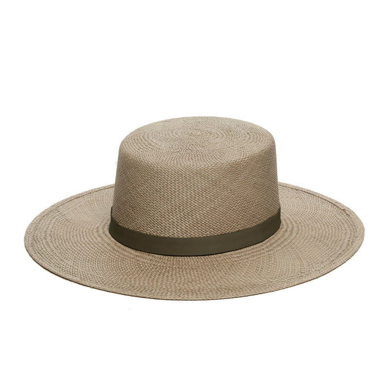 beige panama straw boater for women with tonal leather band and gold screw detail by janessa leone. hats that are great for sun protection and traveling abroad. UPF 45+ panama silver sage straw. Beige hat with flat top and brim