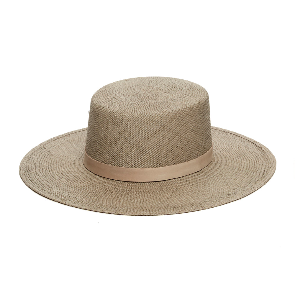 Rena designed by janessa leone with handmade materials. Brown beige boater style hat for women. Beige band. Tonal summer hat can be worn year round. Flat brimmed boater hat for women made with quality straw and handwoven