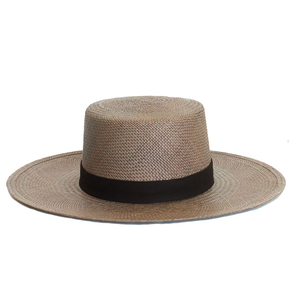bernt by janessa leone | java brown straw boater made from panama straw great for winter and summer vacation | provides the highest strength of sun protection flat brimmed flat crown boater style hat with black leather band and gold screw at back of hat | luxury high end boater hats fashion hats for women