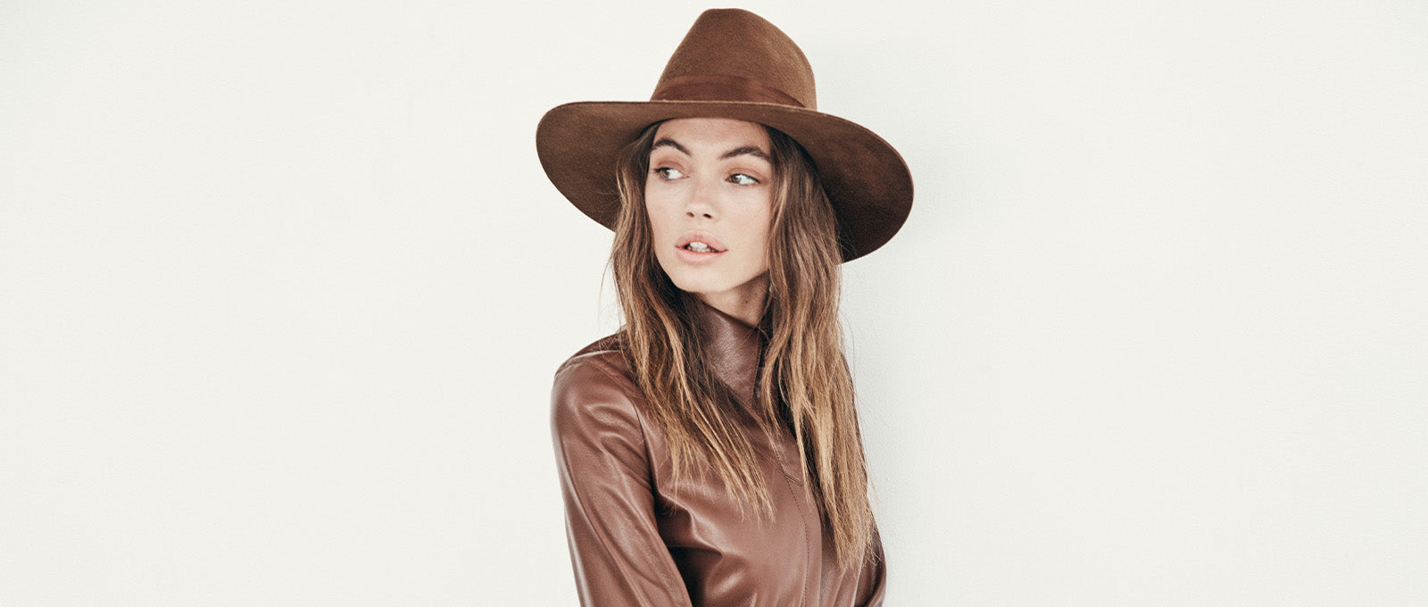 Beautiful brown wool hat in whiskey. Brown suede band. gold screw detail- all-brown monochromatic fedora virgin wool. women's winter fedora with stiff brim and crown. Structured wool fedora for winter. Woman's luxury high end hats made by Janessa Leone fall winter 2019