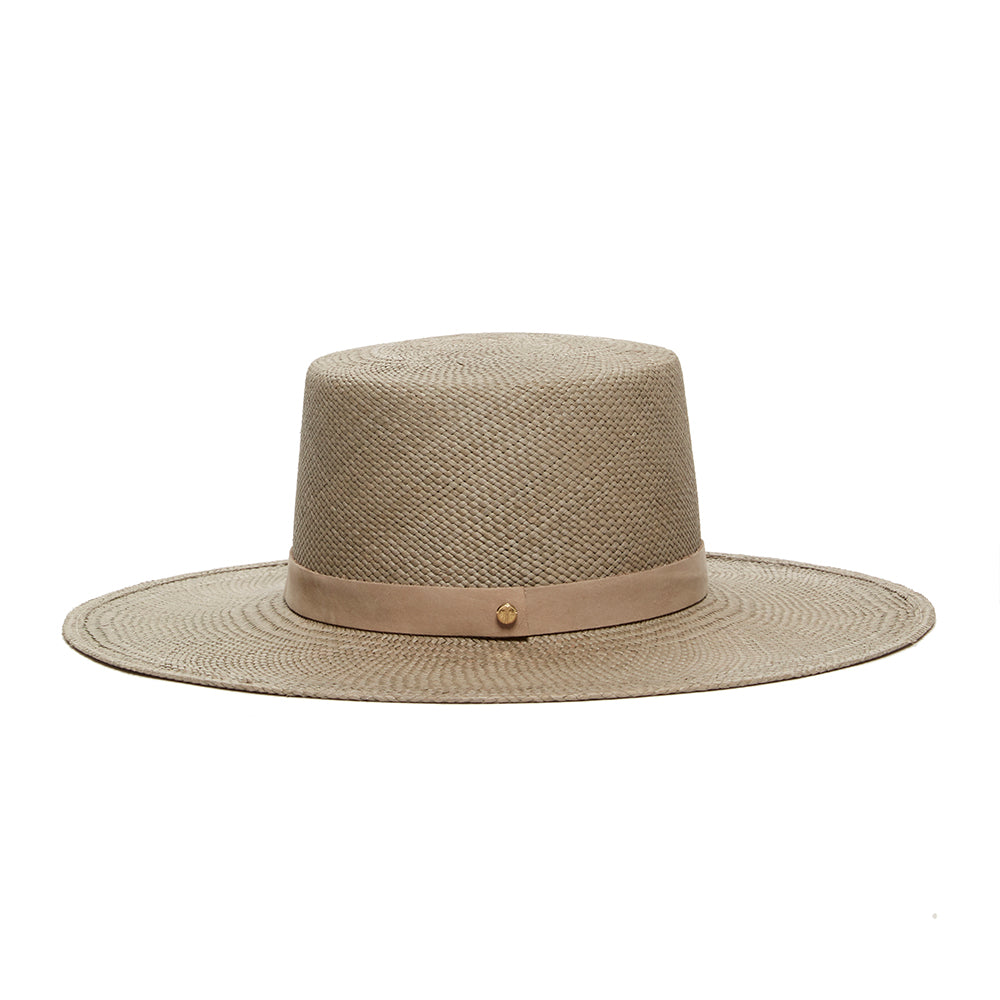 Brown and beige boater style hat with 100% panama straw. High end luxury hats by Janessa Leone great for summer and optimal sun protection. Received a 50+ ultraviolet protection rating.