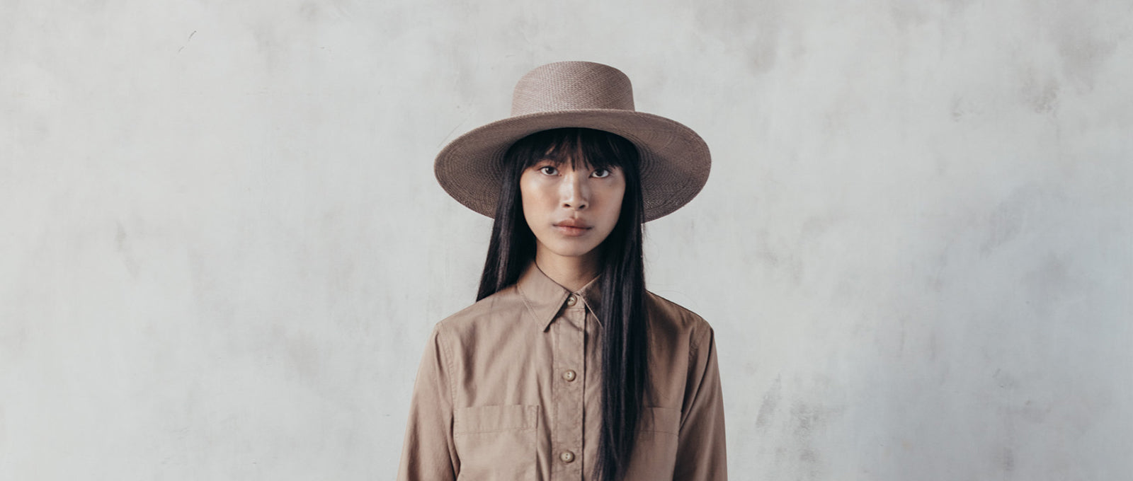 Janessa Leone summer hats for women. Brown beige boater hat with tonal band and flat brim. Flat top hat with quality materials. high end luxury style boater hat for women