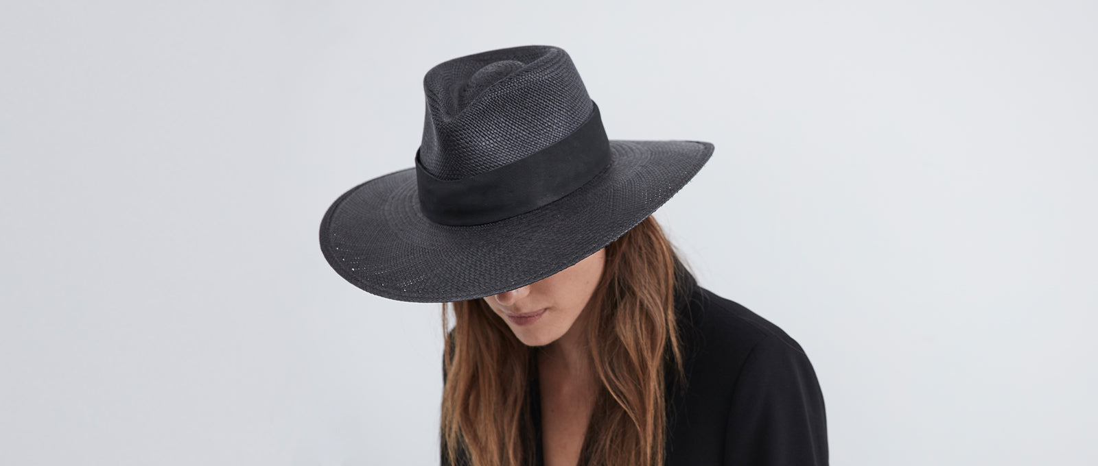 janessa leone fedora all black straw with thick black leather band made from panama straw. UPF rating 45+ for sun protection womens sun hats modern