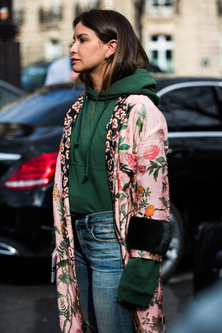 Bomber jacket over hoodie street style