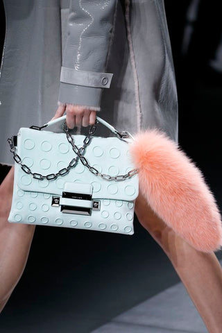Baby blue bag with peach fur runway