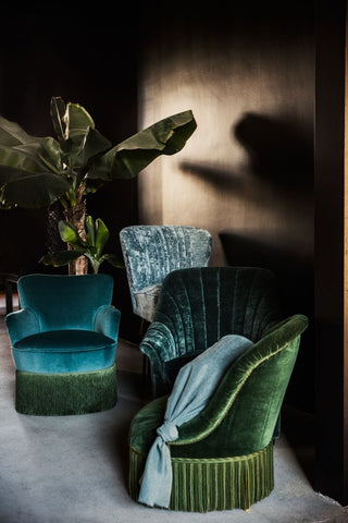 Velvet green interior space and chairs
