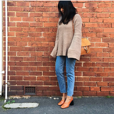 Beige knit jumper with denim jeans Street style
