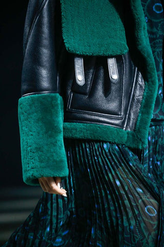 Green biker jacket runway
