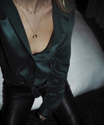 Green shirt leather pants gold jewellery