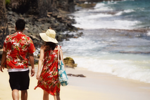 a couple with matching clothes walking along the beach