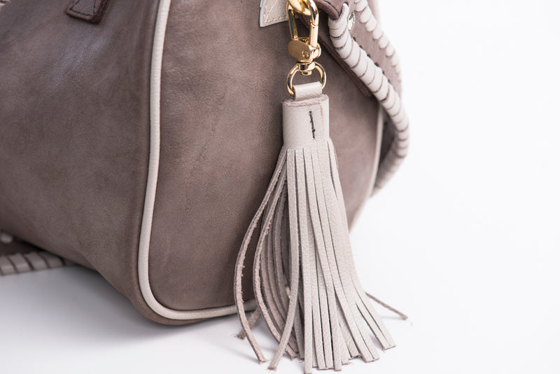 Light leather tassel on the side of Soul Carrier's True North brown satchel