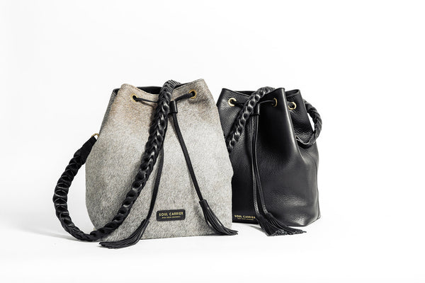 Bucket bag made of cowhide or black leather from The Essentialist Collection by Soul Carrier
