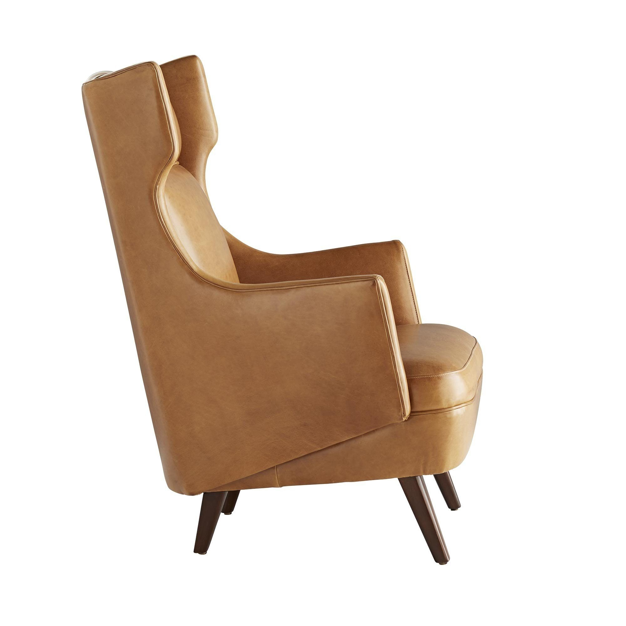 Modern wing chair in cognac leather seating global home