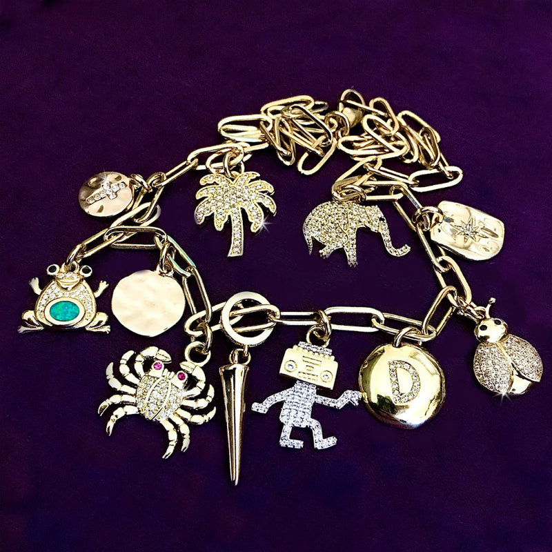 From the Dawn of Man to Alex and Ani, Charm Jewelry is Still Loved