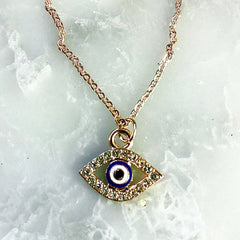 Gold crystal evil eye pendant