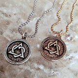 Bbeni adoption coin necklace