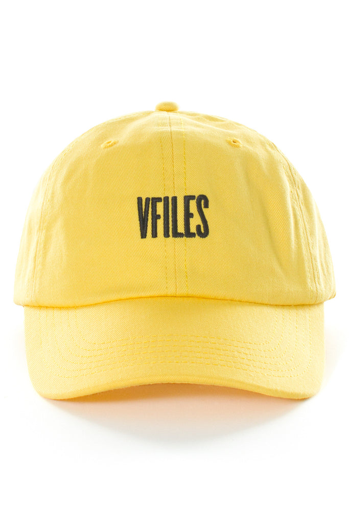 「VFILES LOGO CAP Yellow baseball cap featuring black VFILES logo on front and adjustable buckle closure in back. 100% cotton. SIZE & FIT One size. Adjustable. VFILES」の画像検索結果