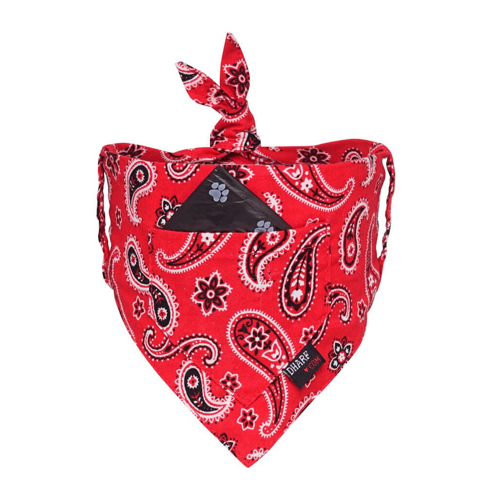 A red paisley bandana for dogs. This bandana has a front pocket for storing poo bags and can be attached to any collar including the matching red paisley collar.