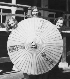 Three 1930's gals around a Parasol!