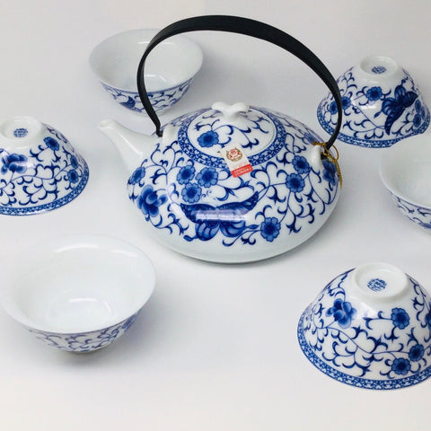 Porcelain tea set with Butterfly flowers and Metal handle