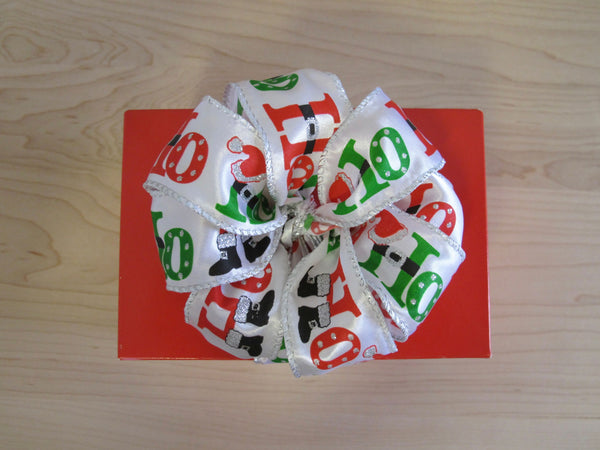 Red Square Box tied with Ho Ho Ho ribbon with 6 Cookies