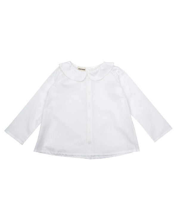 A classic white peter pan collar shirt for kids.