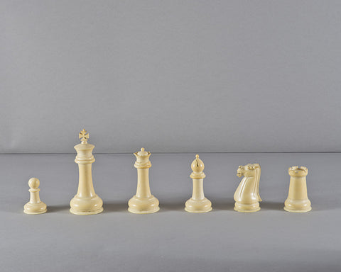 A Chinese Staunton Ivory Chess Set and Board