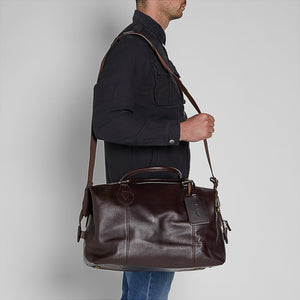 BARBOUR TRAVEL EXPLORER BAG - CHOCOLATE BROWN LEATHER - UBA0008BR91 - Modelled on Shoulder