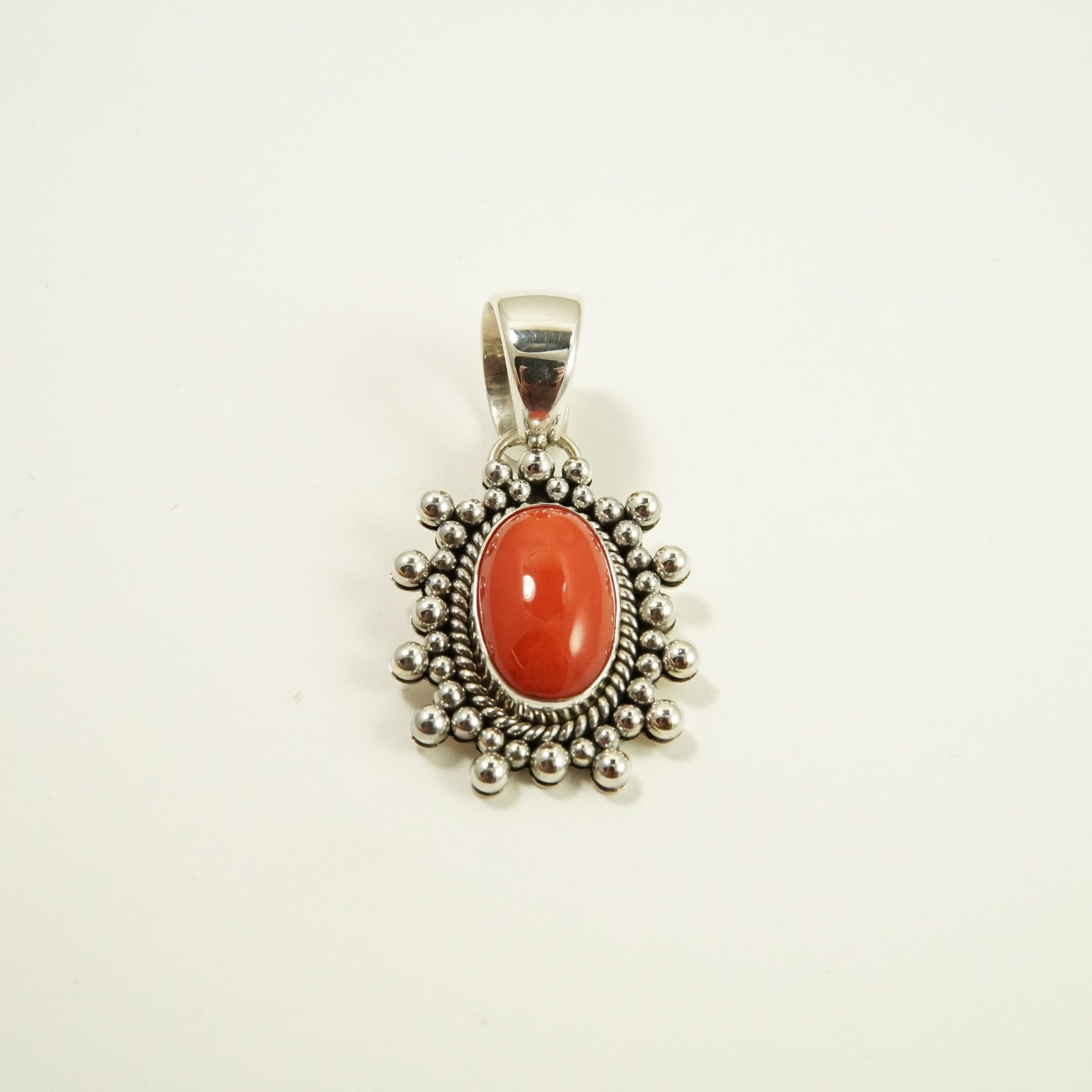 Coral Pendant by Artie Yellowhorse