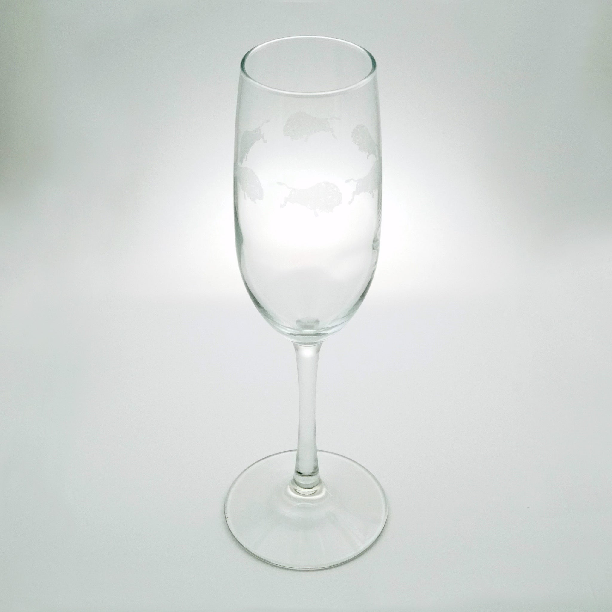 Etched Buffalo Champagne Flute Glass