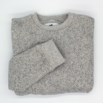 "Rudder USA Captain's Crewneck Sweater. Preppy Unisex Crewneck Sweater in our Salt & Pepper Color. Sweater is folded in image emphasizing clean details in round neckline and sleeve cuff. Rudder USA Captain's Crewneck Sweater folded in our grey ""Salt & Pepper"" classic style."