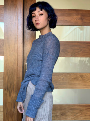 Side view of Sheer denim ribbed knit sweater knit in California