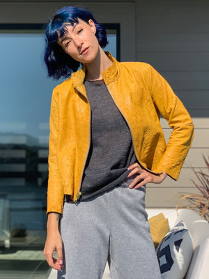 Yellow leather jacket with knit tank and wide leg pants