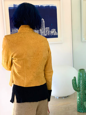 Yellow leather jacket with back darts and double neckline