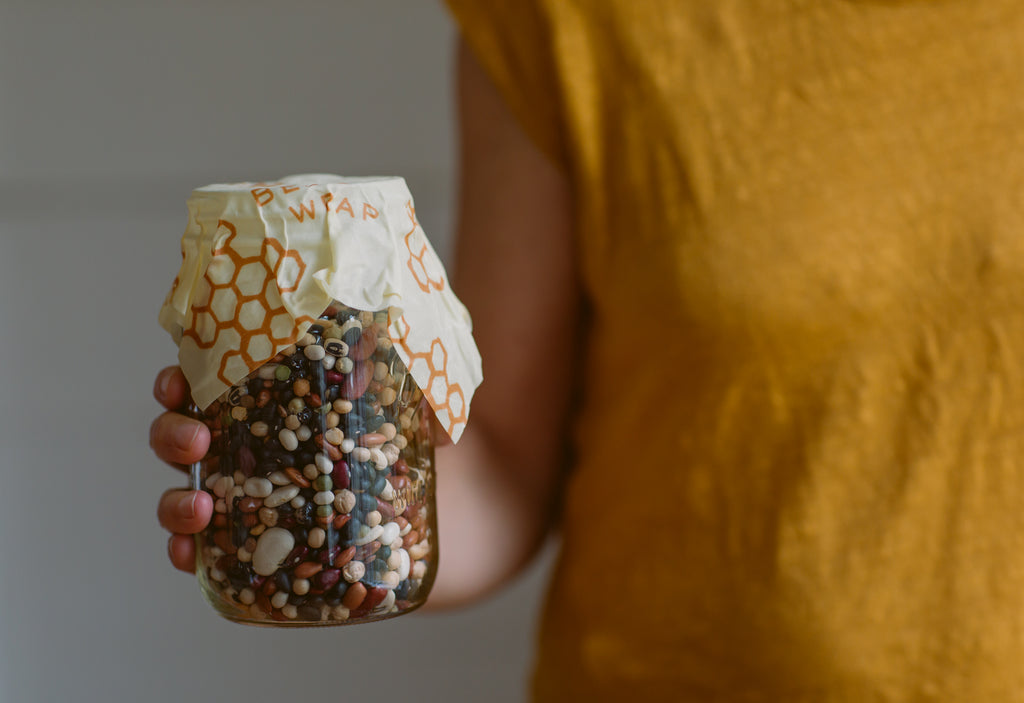 jar of dry beans with bees wrap