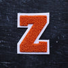 "Varsity Letter Patch, 3.5"" Full Block font. ORANGE/WHITE"