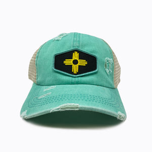 Stain Washed Turquoise Crisscross Ponytail Trucker Cap
