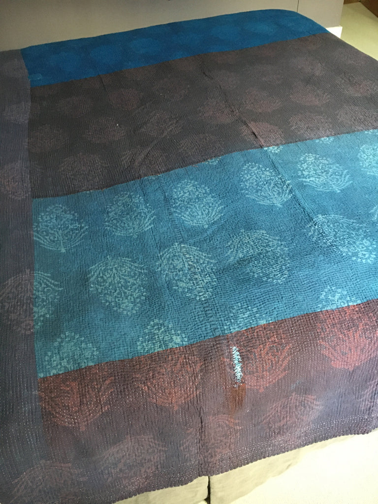 large blue, green and purple block printed bedspread