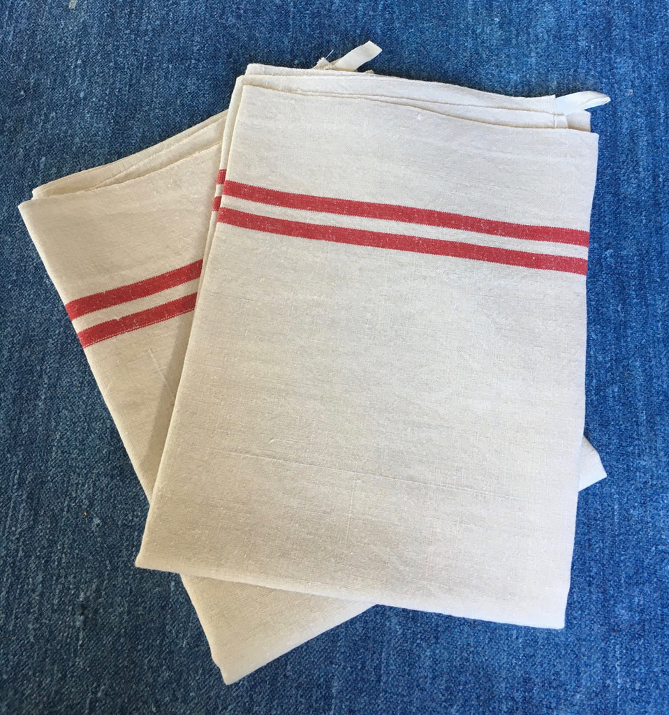 pair of french tea towels with red stripe natural unbleached linen dish cloths by Rebecca's Aix Home