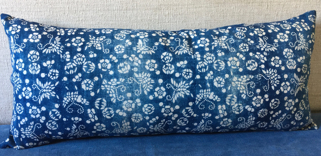 vintage chinese paste resist bolster cushion  in blue and white indigo with linen reverse