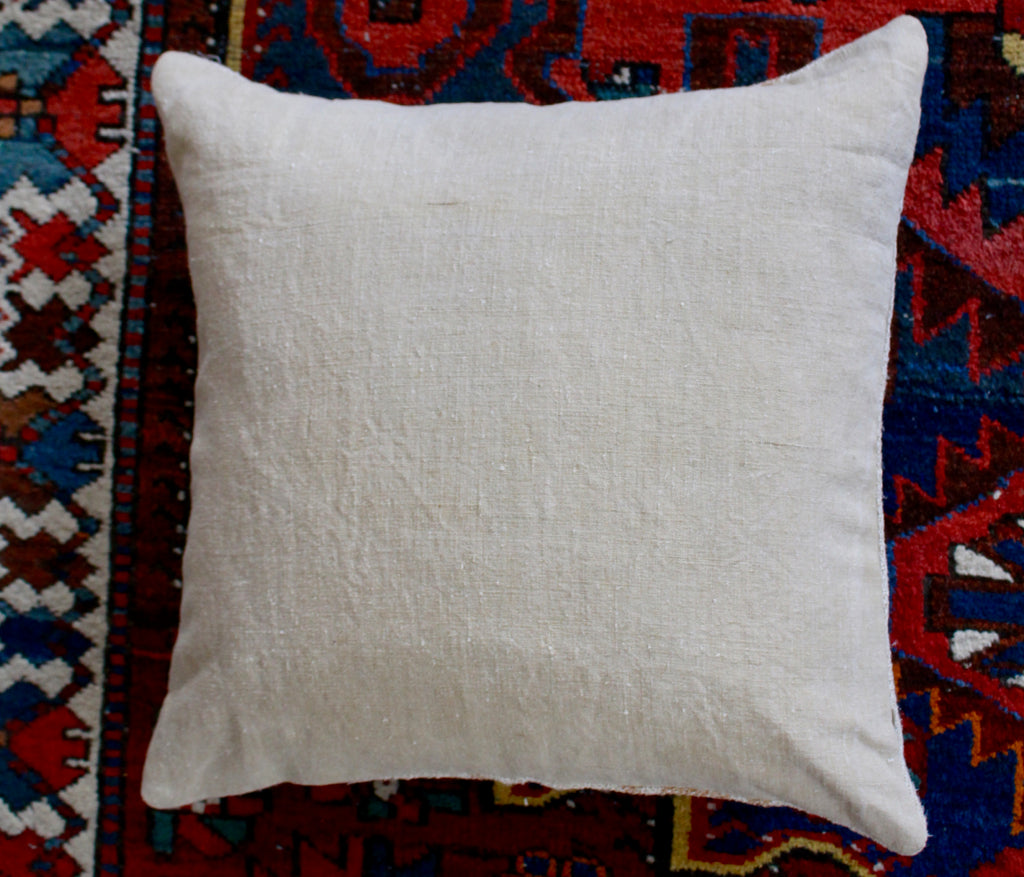 reverse side of vintage Hungarian grain sack cushions with soft yellow stripe