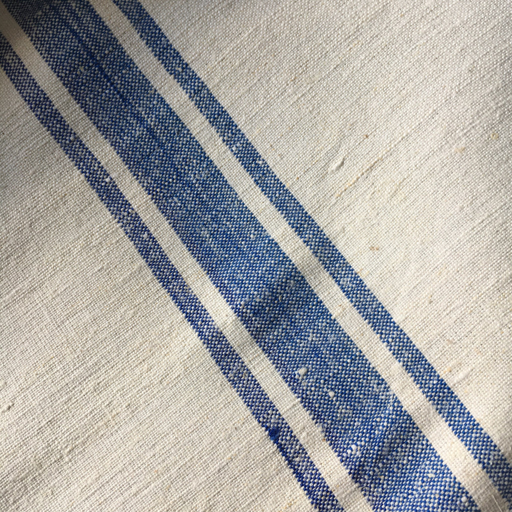roll of blue stripe vintage linen for upholstery and cushions