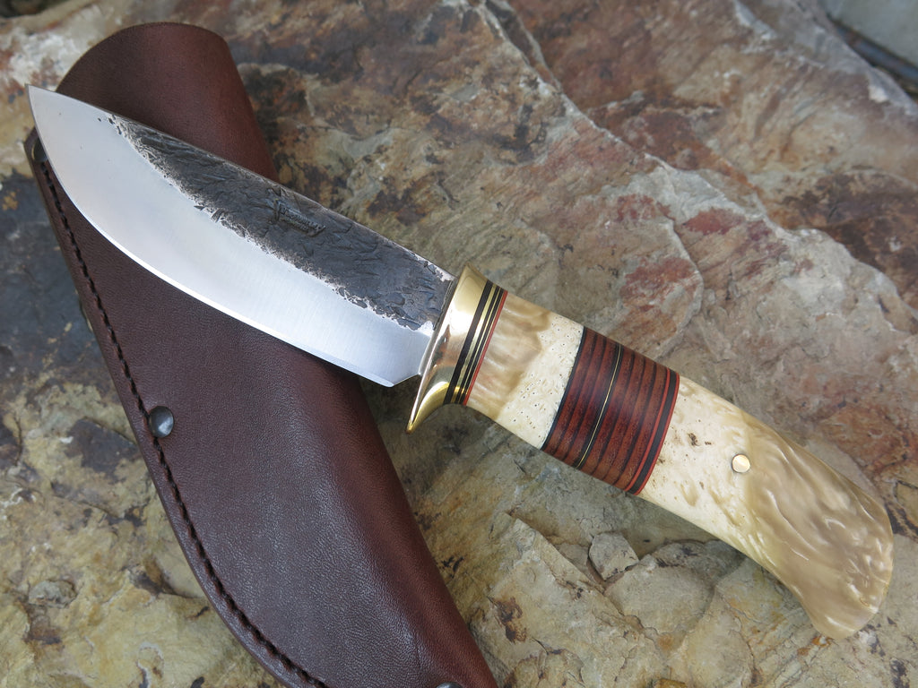 Premium Musk Ox Boss and Horsehide Drop Point