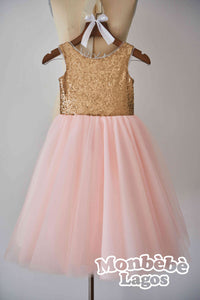 Gold Sequin Dress With a Silver Bow