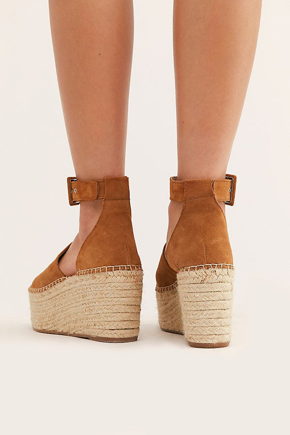 Camel coloured suede wedge sandals from Free People with wide toe strap, buckled ankle strap and espadrille platform sole.