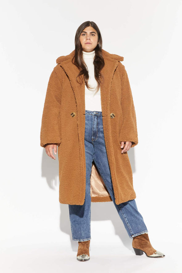 The Daryna - Camel Faux Shearling coat from Apparis is a carmel coloured, faux shearling double breasted coat with a notch lapel collar.