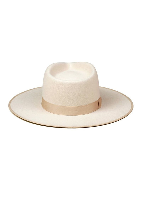 The Ivory Rancher by Lack of Color is designed to make a statement. The 100% Australian wool fedora is a stunning ivory colour with a tonal gold ribbon.