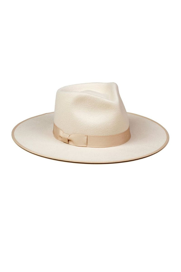 The Ivory Rancher by Lack of Color is designed to make a statement. The 100% Australian wool fedora features a tonal gold bow.