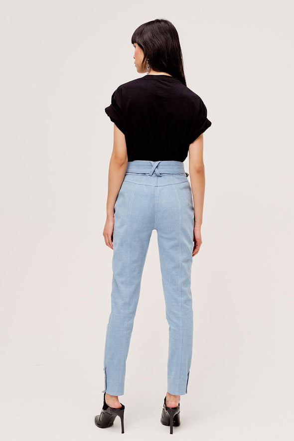 Light blue western inspired high waist pants from For Love & Lemons with contrast stitching and functional metal button details.