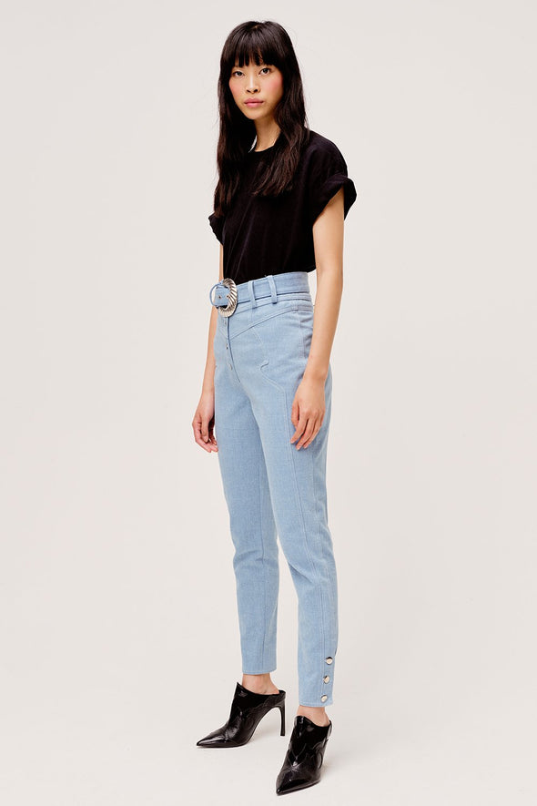 Western inspired light blue high waisted pants from For Love & Lemons with removable belt and contrasting metal button details.